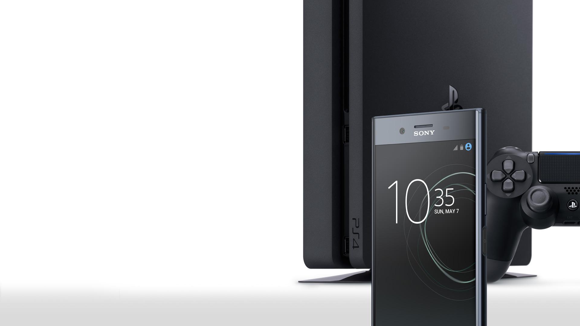 Sony Xperia XZ Smartphone mit PlayStation 4 und Dualshock 4 Controller auf weißem Hintergrund
