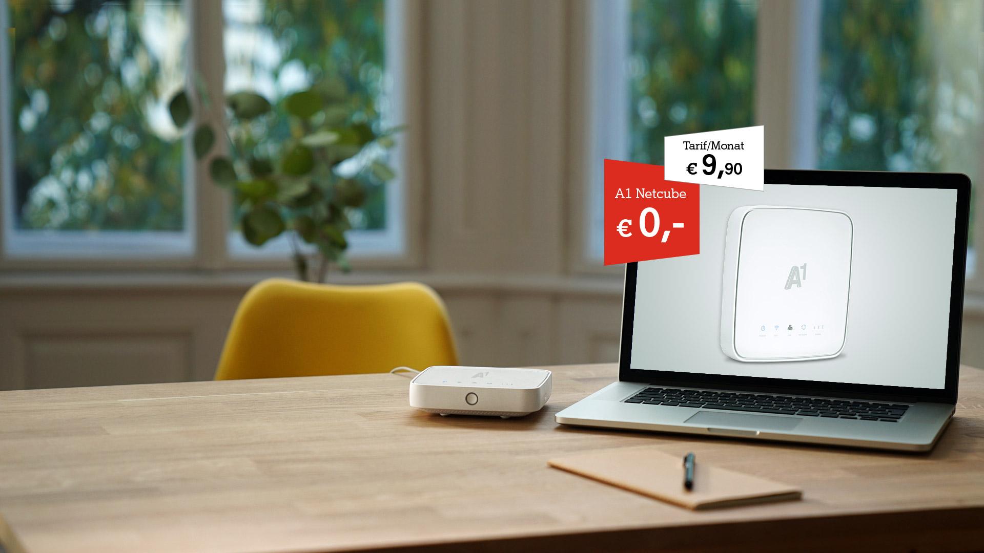 A1 Net Cube 2 neben einem Laptop auf einem Tisch. A1 Net Cube um € 0,- und Tarif um € 9,90.
