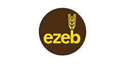gelber Schriftzug ezeb mit einem Getreidehalb über dem b in einem braunen Kreis auf weißem Hintergrund